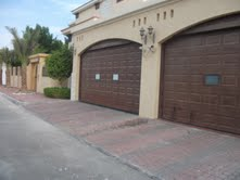 Garage Door Suppliers UAE from AL SHERA DOORS & SHADES