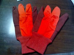 ORANGE COLOR DOTTED GLOVES  from SAFELAND TRADING L.L.C