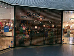 SHOP FRONT SHUTTER - POLYCARBONATE/PERFORATED from DESERT ROOFING & FLOORING CO L L C (DOORS DIVISION)