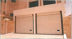 OVERHEAD SECTIONAL GARAGE DOOR & CARRIAGE DOORS