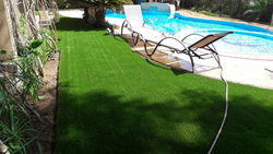 Artificial Grass with Swimming Pool from ABDULNASER AL HASHEMI LANDSCAPE GARDENING
