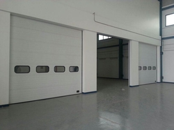 SECTIONAL OVERHEAD DOOR SUPPLIERS IN UAE from DESERT ROOFING & FLOORING CO L L C (DOORS DIVISION)